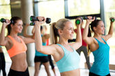 Group of women with dumbbells in gym — Stockfoto