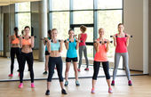 Group of women with dumbbells in gym — Stock Photo