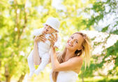 Happy mother with little baby in park — Stock Photo