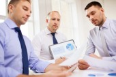 Serious businessmen with papers in office — Stock Photo