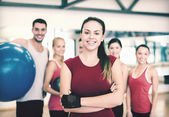 Woman standing in front of the group in gym — Stock Photo