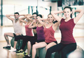 Group of people working out in pilates class — ストック写真