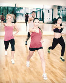 Group of concentrated people exercising in the gym — Photo