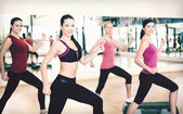 Group of smiling people doing aerobics — ストック写真