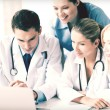 Team or group of doctors working — Stock Photo #54632911