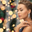 Beautiful woman wearing ring and earrings — Stock Photo #54633431