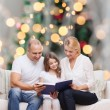 Happy family with book at home — Stock Photo #54635173