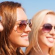 Close up of smiling young women in sunglasses — Stock Photo #54637243