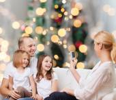 Happy family with camera at home — Stock Photo