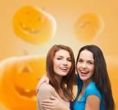 Smiling teenage girls hugging — Stock Photo