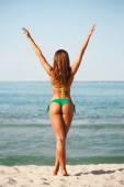 Young woman sunbathing on beach — Stock Photo