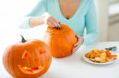 Close up of woman with pumpkins at home — Stock Photo