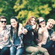 Group of students or teenagers showing thumbs up — Stock Photo #54837489