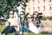 Students showing smartphones — Stock Photo