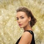 Beautiful woman in evening dress wearing earrings — Stock Photo #54850203