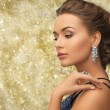Beautiful woman wearing ring and earrings — Stock Photo #54850261