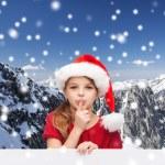 Smiling little girl in santa helper hat — Stock Photo #54851187