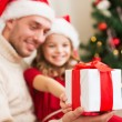 Close up of father and daughter with gift box — Stock Photo #54853361