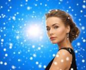 Beautiful woman in evening dress wearing earrings — Stock Photo