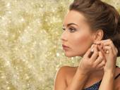 Close up of woman wearing earrings — Stock Photo