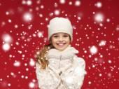 Smiling girl in white hat, muffler and gloves — Stock Photo