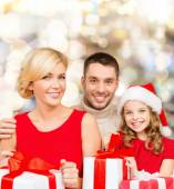 Happy family with gift boxes — Stock Photo