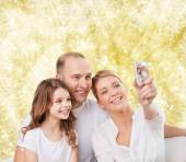 Happy family with camera at home — Foto Stock