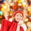 Smiling young woman with shopping bags — Stock Photo