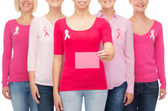 Close up of women with cancer awareness ribbons — Stock Photo