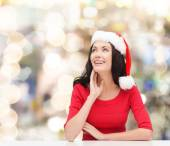 Donna sorridente nel cappello di santa helper — Foto Stock