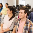 Group of smiling students in lecture hall — Stock Photo #55200751