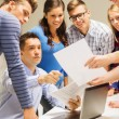 Group of students and teacher with laptop — Stock Photo #55201477
