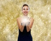 Laughing woman in evening dress holding something — Stock Photo