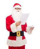 Man in costume of santa claus with letter — ストック写真