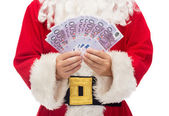 Close up of santa claus with euro money — Zdjęcie stockowe