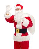 Man in costume of santa claus with bag — Stock fotografie
