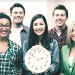 Group of students at school with clock — Stock Photo #55527207