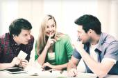 Group of students gossiping at school — Stock Photo
