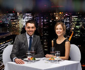 Smiling couple eating main course at restaurant — ストック写真