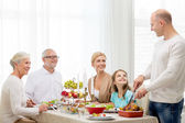 Smiling family having holiday dinner at home — Foto de Stock
