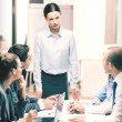 Strict female boss talking to business team — Stock Photo #55786345