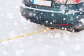 Closeup of towed car with towing rope — Stock Photo