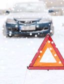 Closeup of warning triangle and car — Stock Photo