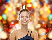 Smiling woman in evening dress wearing crown — ストック写真