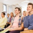 Group of smiling students in lecture hall — Stock Photo #55806085