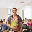 Group of smiling students in lecture hall — Stock Photo #55806583