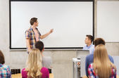Group of students and teacher in classroom — Stock Photo