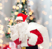Man in costume of santa claus with bag — Zdjęcie stockowe