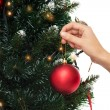 Close up of woman with christmas tree decoration — Stock Photo #55989809