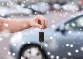 Close up of man with car key outdoors — Stock Photo